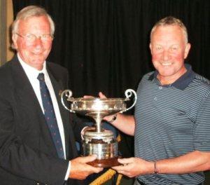 CHAMPION: Tony Holt, right, recieves the senior trophy from county president David Eccleston