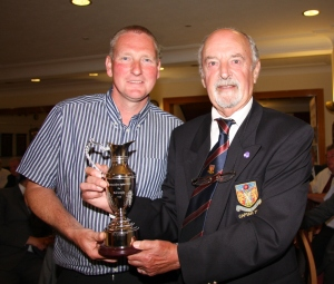 Morecambecaptain Ron Butler (right) presents best individual performer Mark Needham with the Neil Kemplay trophy