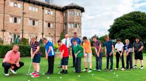 ON THE BALL: Chorley Golf Club PGA professional Mark Bradley gives the youngsters a few putting tips.  Back left is Ron Pottage next to Andy Leigh