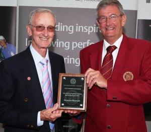 PGA captain Neil Selwyn-Smith presents a  plaque to Howard Bennett