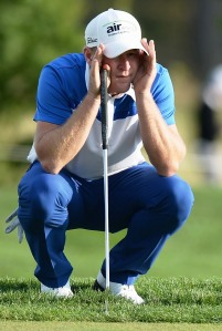 WHAT'S MY LINE: Jamie Donaldson studies a putt