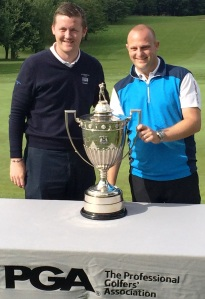 ALL YOURS: Ben Mason receives the Leeds Cup from Oulton Hall golf director Alan Foley