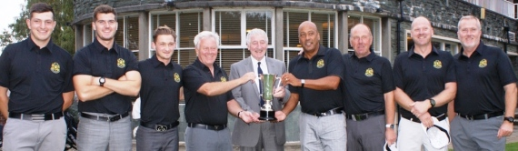 CHAMPS AT LAST: John Down presents the trophy to Bramhall players