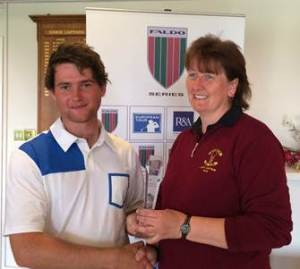HEAD BOY: Joey Lamb receives the trophy from Pleasington lady captain Susan Caton