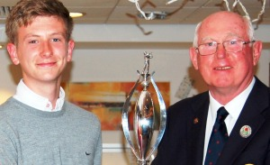 Matthew receives the trophy from county president Tony McMunn