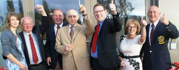 OPENING TIME: Andrew Gwynne and Sir Gerald Kaufman cut the ribbon watched by officials and guests