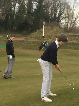 Alex Duckworth putts at 16 watched by Charlie Holland & gary  Byrne.jpg